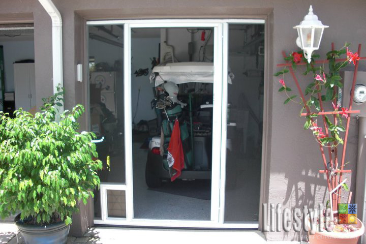 Special golf cart garage door screen shed door screen by for Golf cart garage door